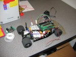 Path Seeker vehicle with Microcontroller, Sensor PCB, and battery packs mounted, side view