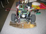 Path Seeker vehicle with Microcontroller, Sensor PCB, and battery packs mounted, front view