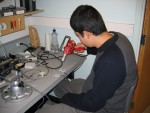 Roberto making battery packs to power the handyboard (microcontroller)